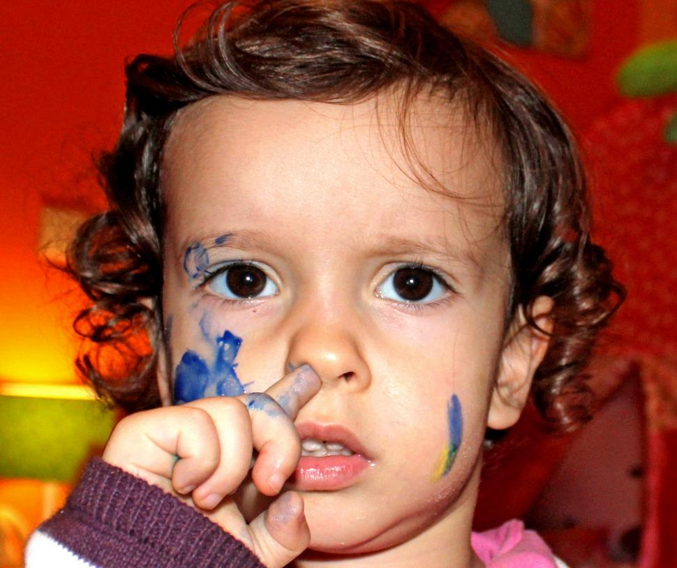 Download Free Stock HD Photo of Child with painted face scratching her nose  Online