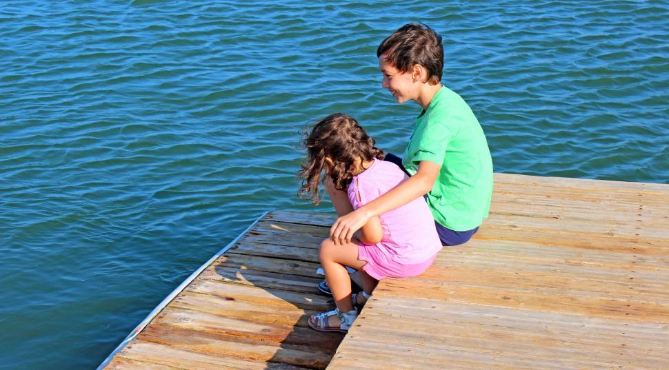 Download Free Stock Photo of Companionship - older brother embracing little sister on the pie