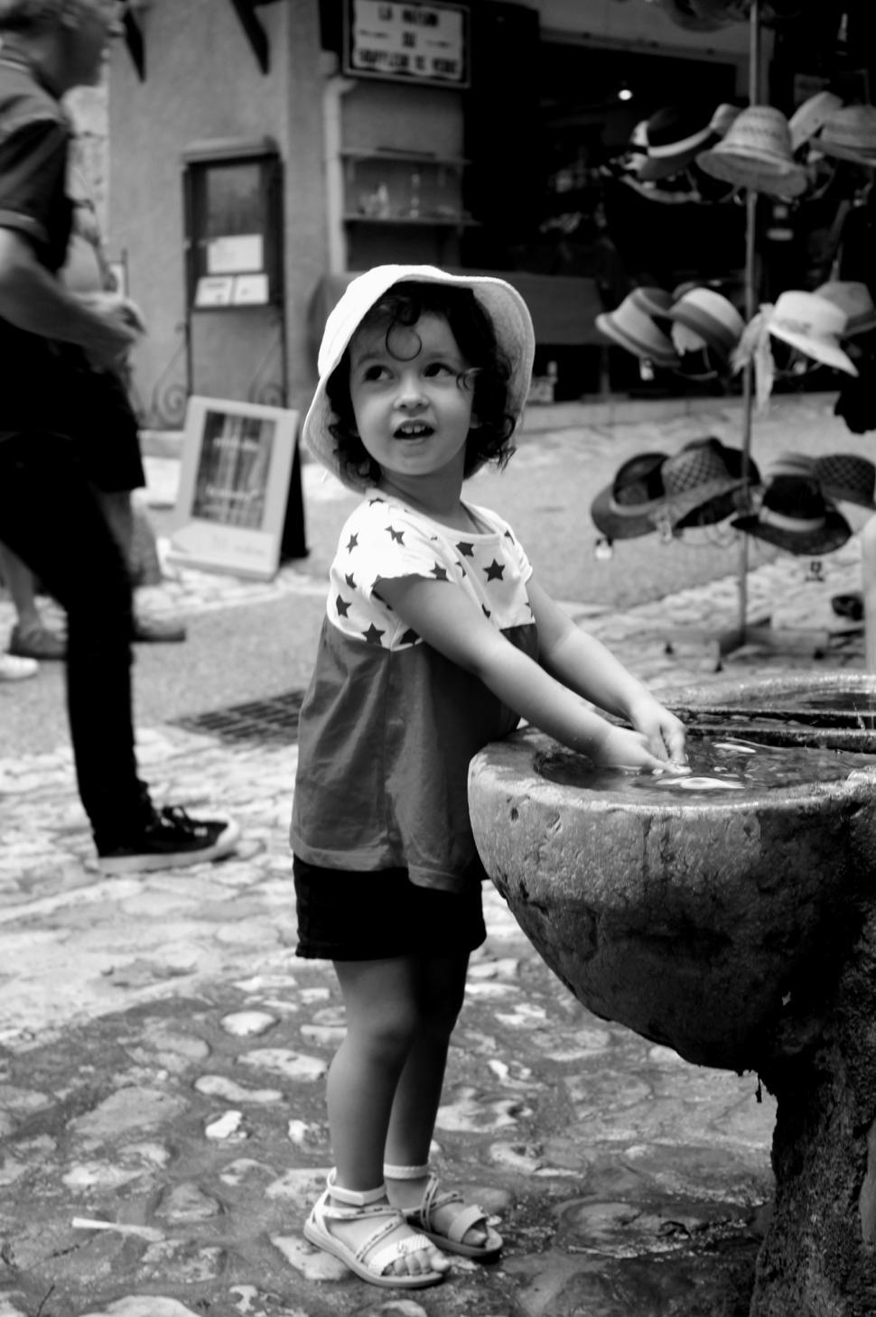 Download Free Stock Photo of Young child washing her hands in the typical village of Moustiers