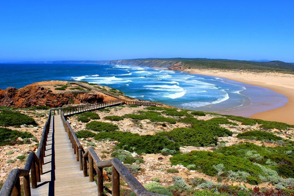 Download Free Stock HD Photo of Long wooden walkway on top of the cliff in Carrapateira Beach, A Online