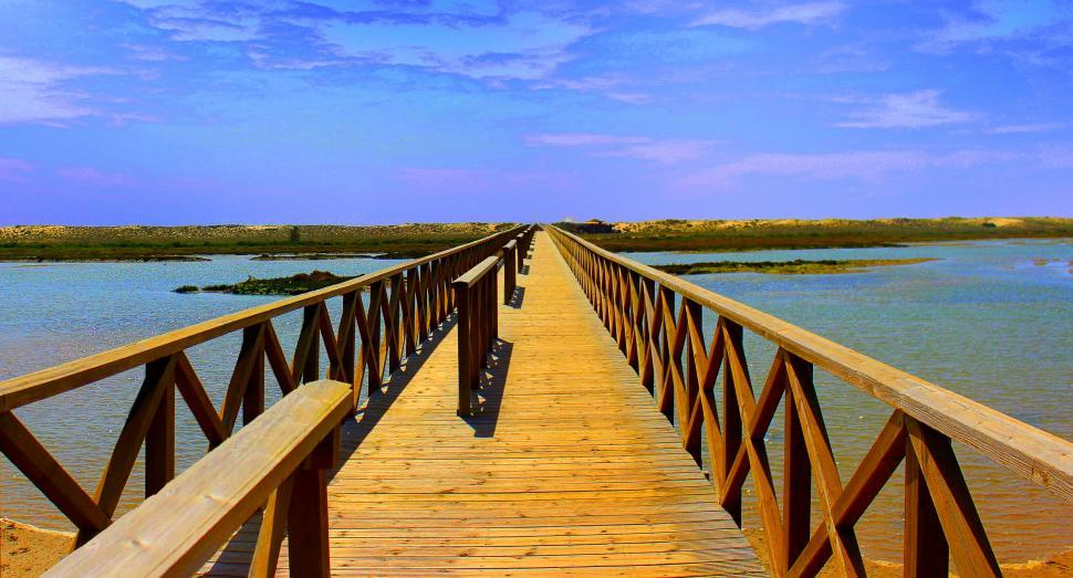 Download Free Stock Photo of Long wooden bridge crossing Ria Formosa at Quinta do Lago beach
