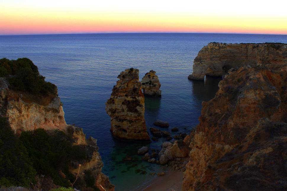Download Free Stock Photo of Sea stacks and sandstone cliffs at dusk - secluded beach in Prai
