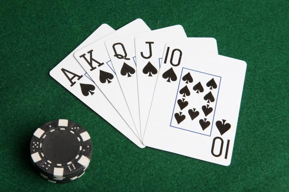 Download Free Stock Photo of Royal flush of spades with black poker chips.
