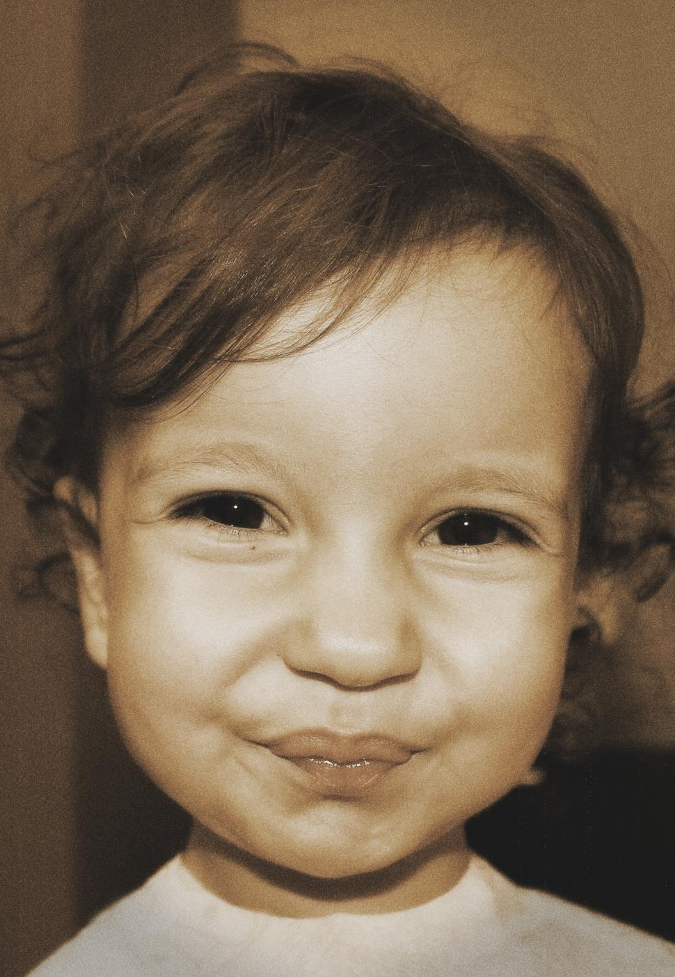 Download Free Stock HD Photo of Toddler smiling in a funny and sweet way - slightly aged sepia t Online