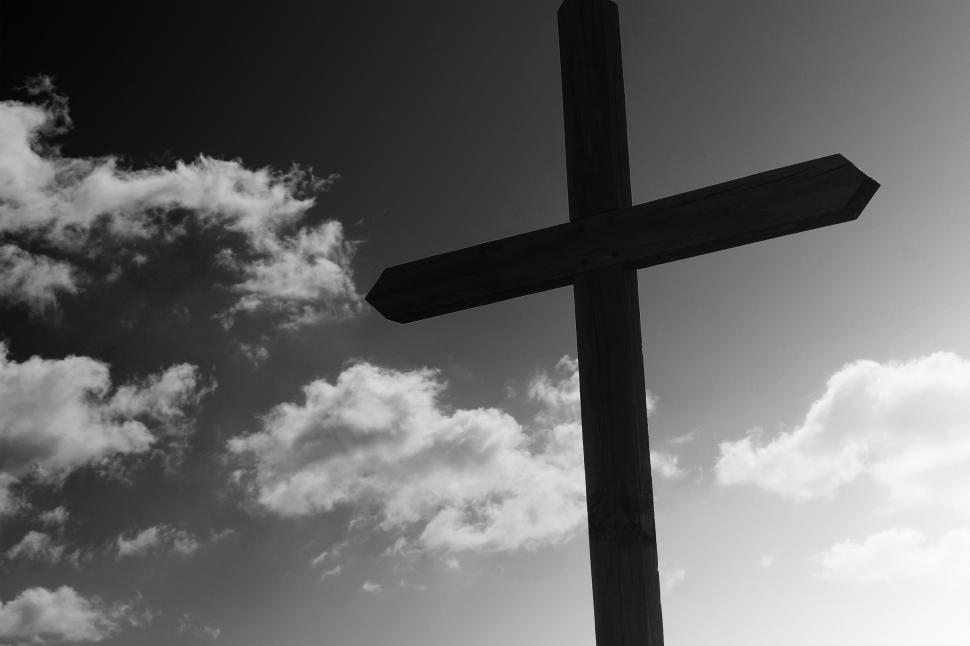 Download Free Stock Photo of Wooden cross against a cloudy sky