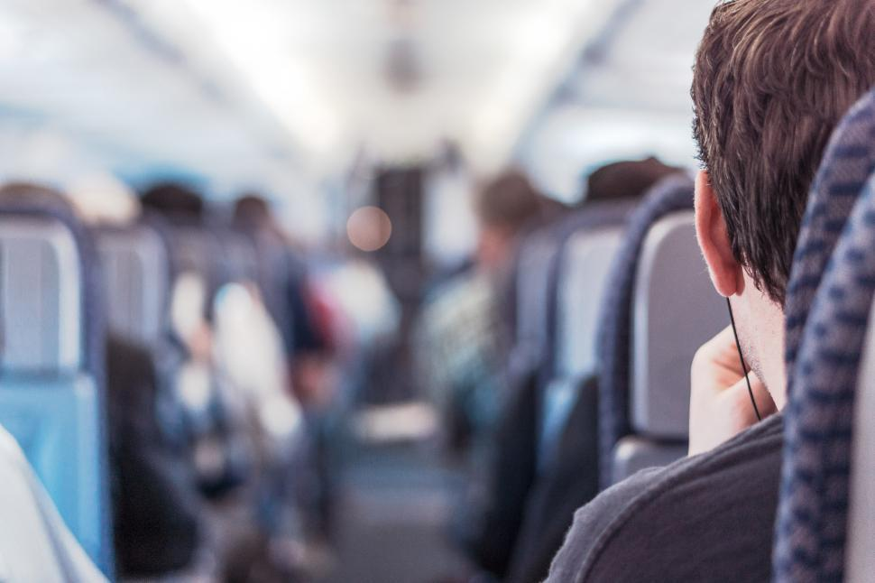 Download Free Stock Photo of Listening to music on the plane