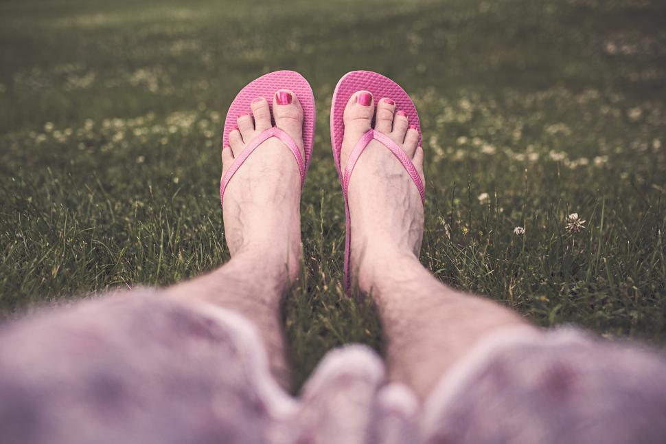 Download Free Stock HD Photo of Feet wearing flip-flops Online