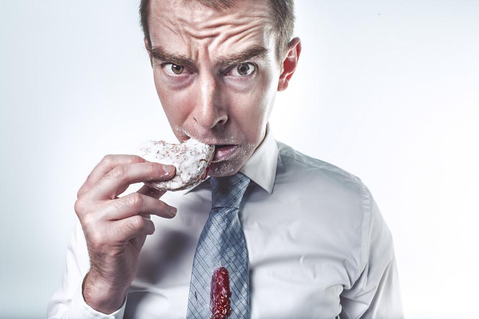 Download Free Stock HD Photo of Businessman with doughnut Online