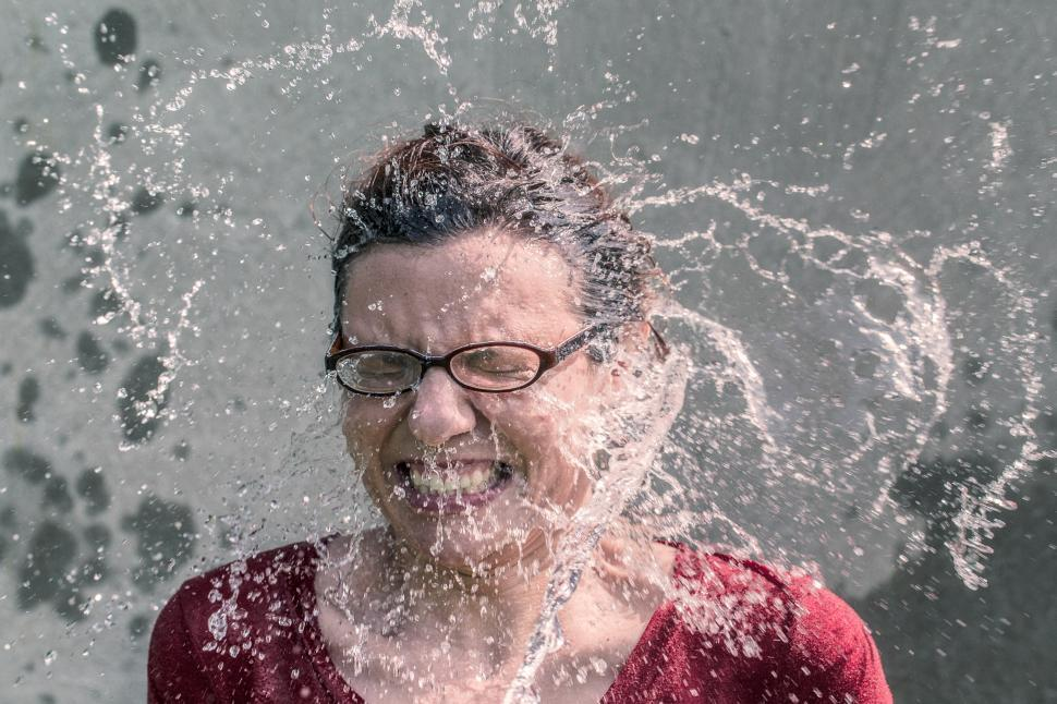 Download Free Stock Photo of Woman splashed with water