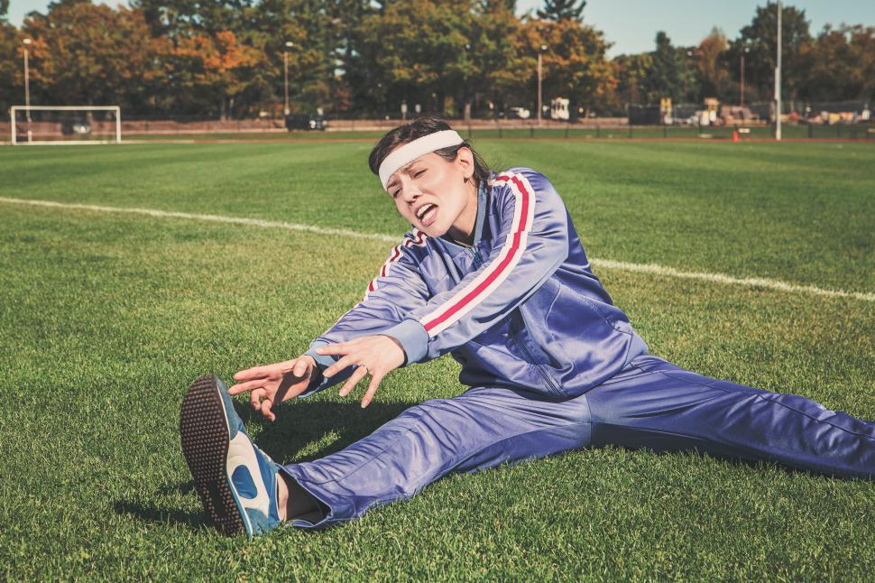 Download Free Stock Photo of Female Athlete trying to stretch