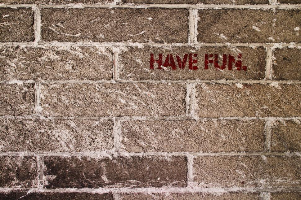 Download Free Stock Photo of Brick Wall says Have Fun