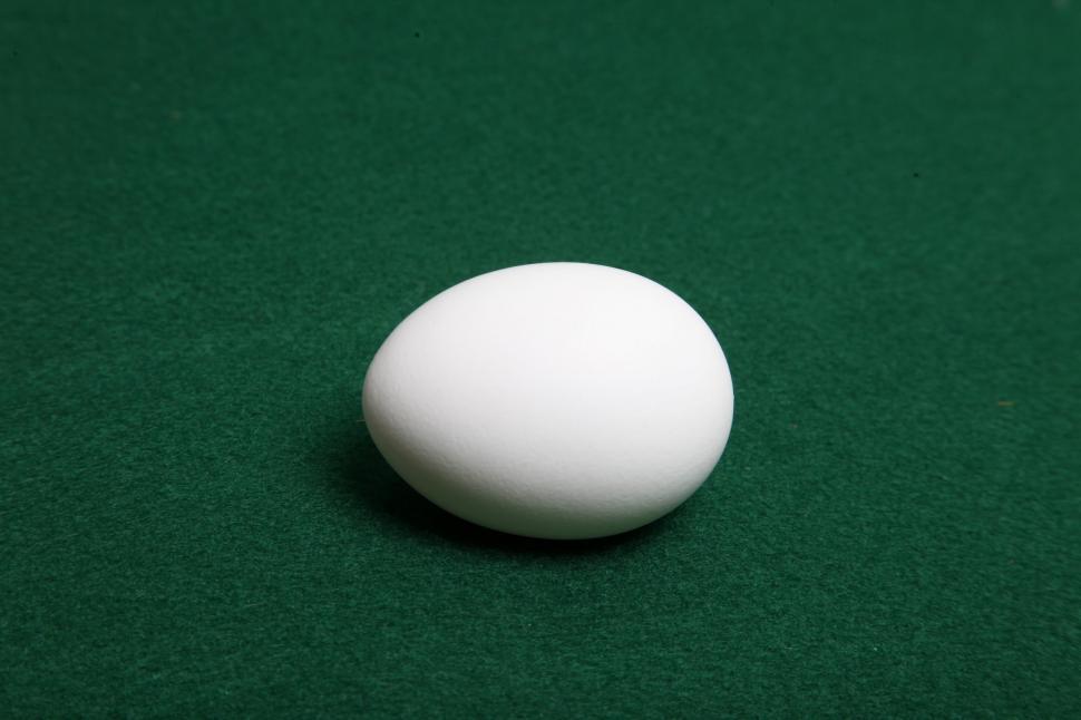 Download Free Stock Photo of Single White Egg on green felt