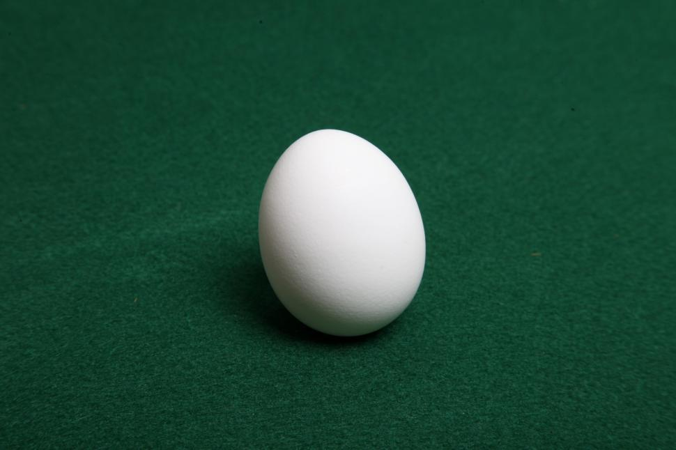 Download Free Stock Photo of Single Egg on green felt