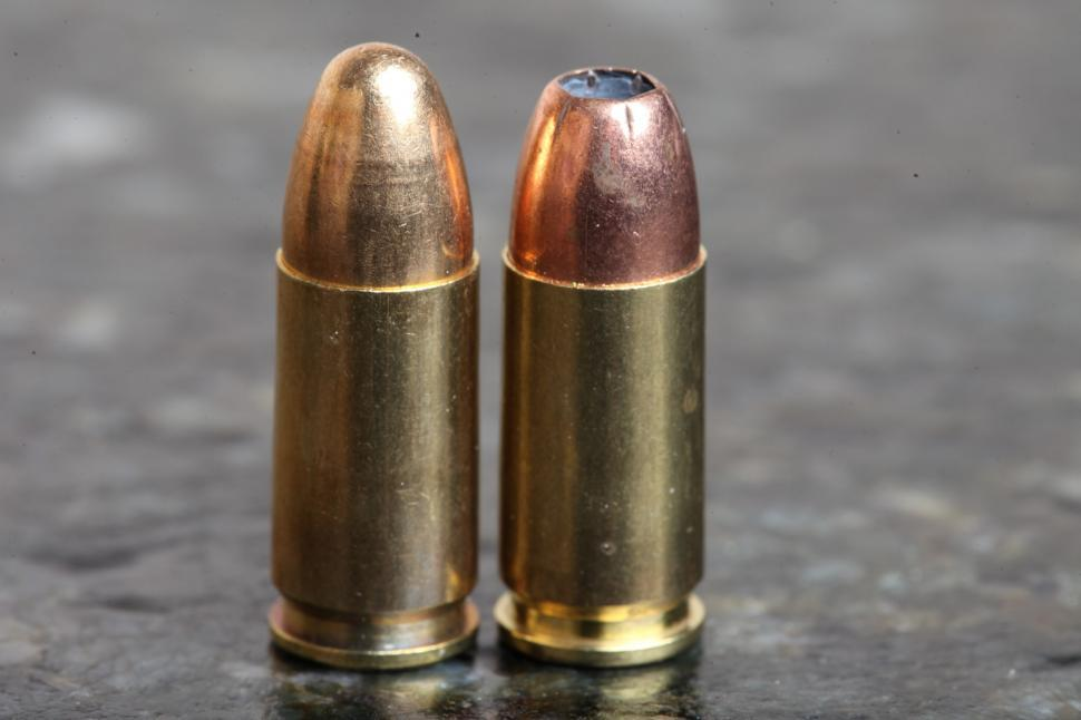 Download Free Stock HD Photo of Two 9mm bullets one hollowpoint Online