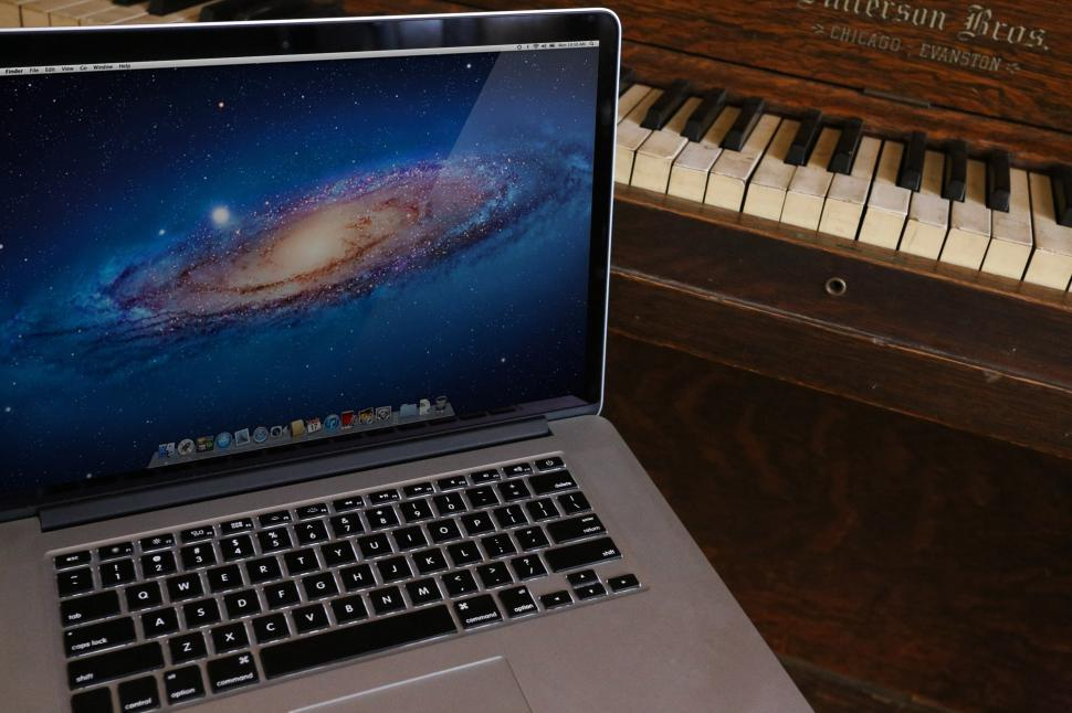 Download Free Stock HD Photo of Macbook and Piano keyboards Online