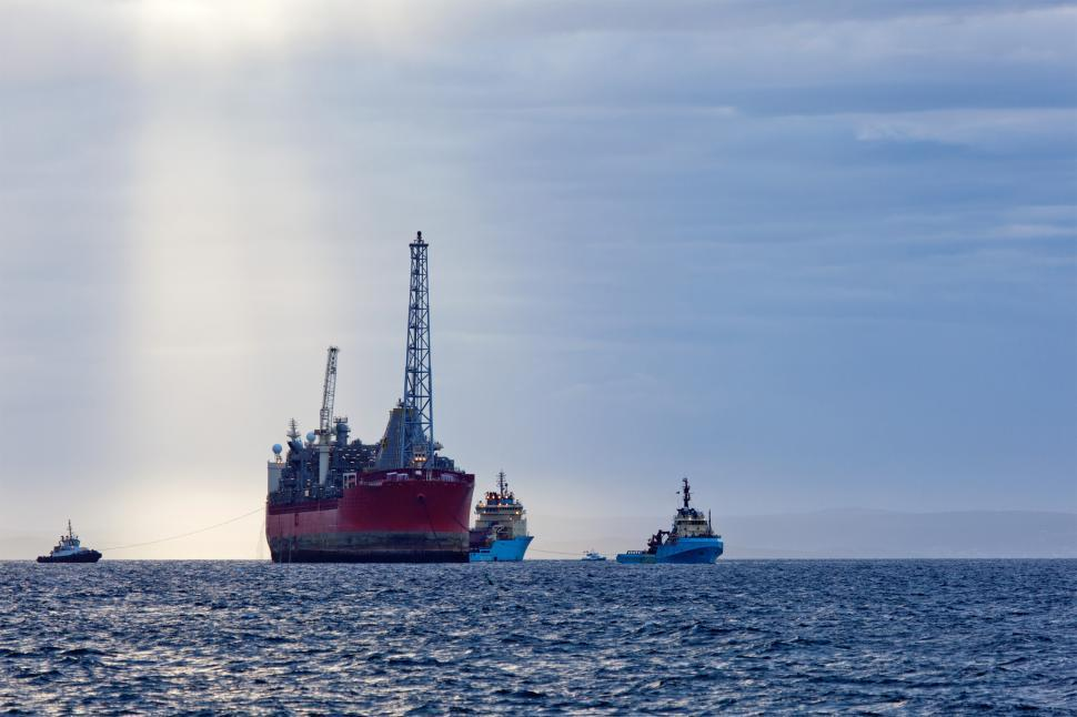 Download Free Stock HD Photo of FPSO with supply ships and pilot boat Online