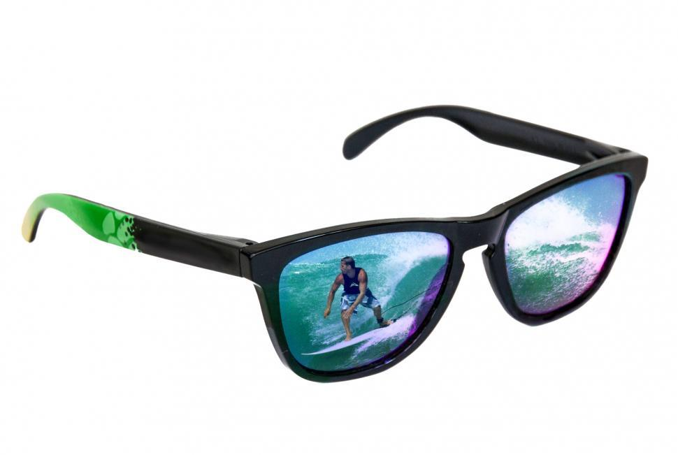 Download Free Stock Photo of Sunglasses with surfer reflection
