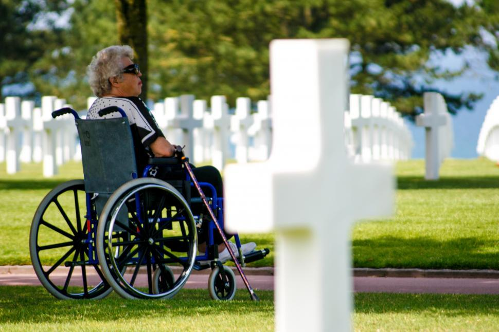 Download Free Stock HD Photo of woman at Military graveyard Online
