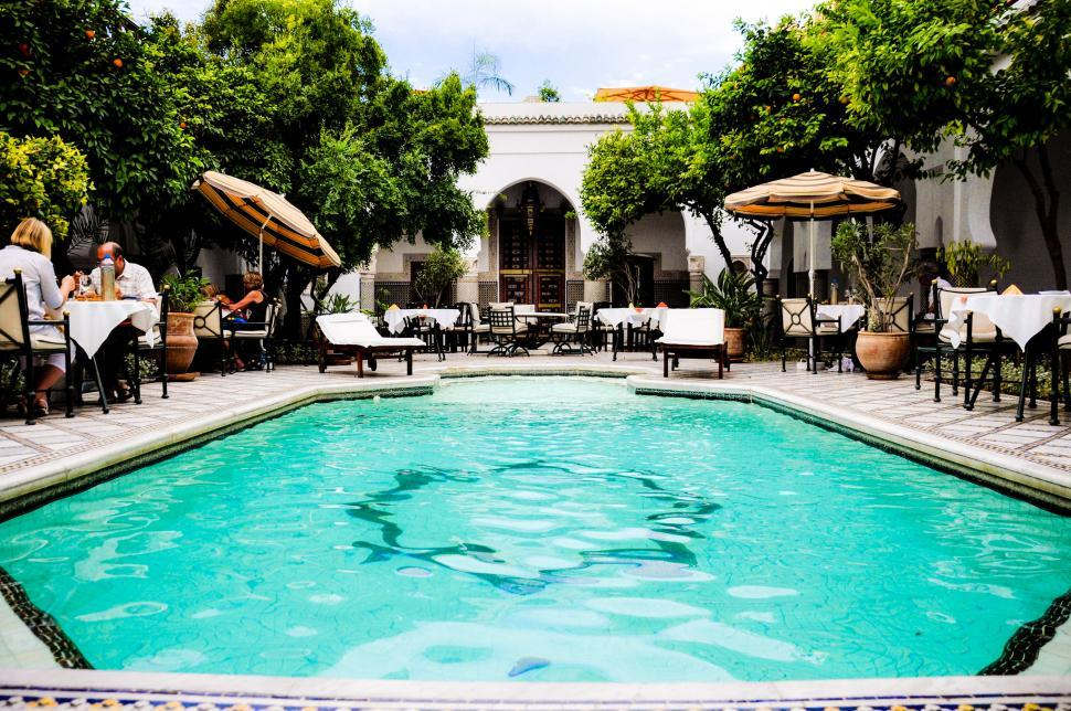 Download Free Stock Photo of Swimming pool and restaurant