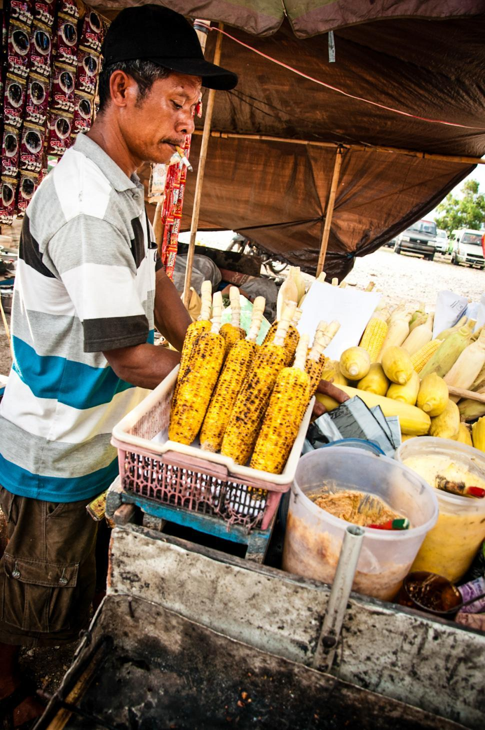 Download Free Stock Photo of street vendor selling corn on the street