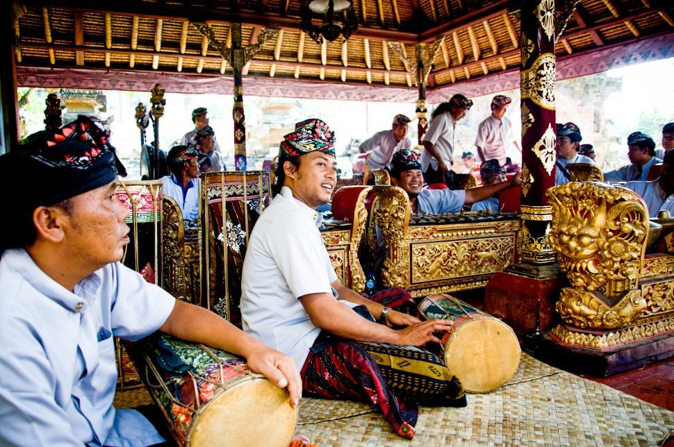 Download Free Stock Photo of Men play traditional gamelan percussion
