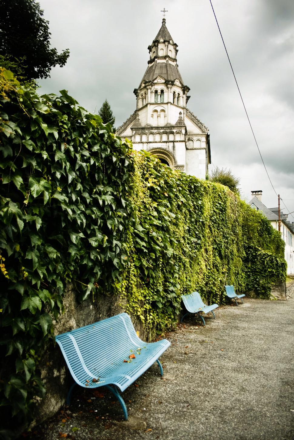 Download Free Stock Photo of Park benches by historical church