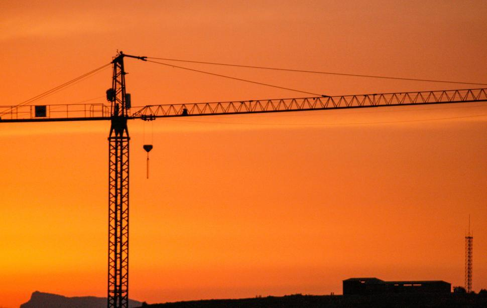 Download Free Stock HD Photo of Crane against the sunset Online