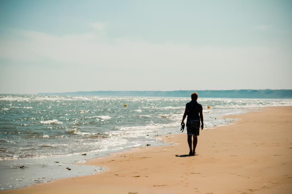 Download Free Stock Photo of person walking on beach