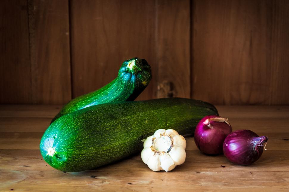 Download Free Stock Photo of Courgette on wood background