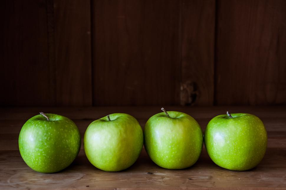 Download Free Stock HD Photo of green apples on a wooden background Online