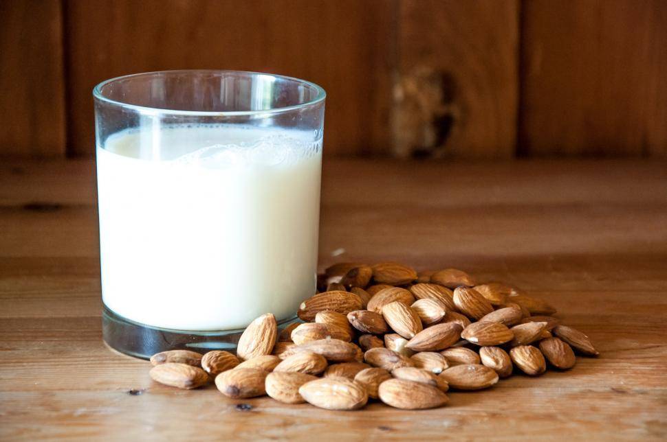 Download Free Stock Photo of Almond milk with almond on a wooden table