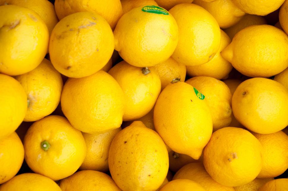 Download Free Stock Photo of Colorful Display Of Lemons In Market