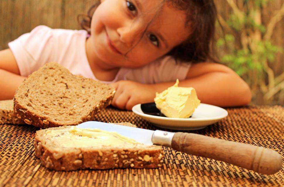 Download Free Stock Photo of Child preparing to eat bread & butter