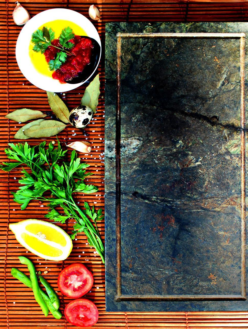 Download Free Stock HD Photo of Basic mediterranean style cooking ingredients on straw Online