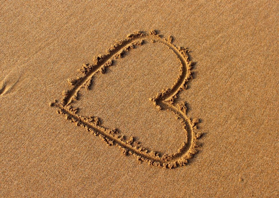 Download Free Stock HD Photo of Heart drawn in the sand Online