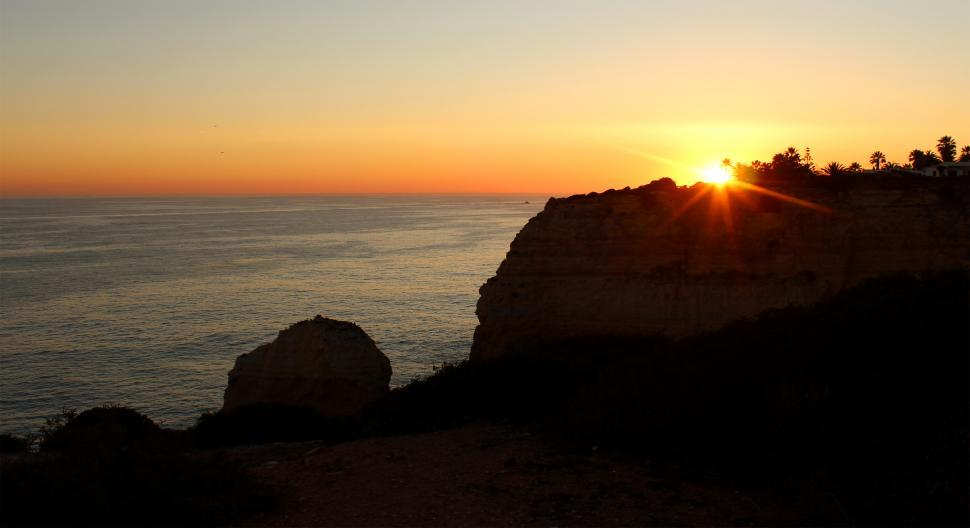 Download Free Stock HD Photo of Sunset over the cliffs in Algarve Online