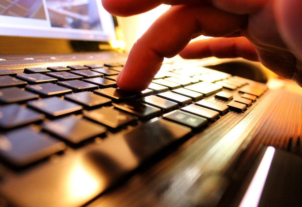 Download Free Stock Photo of Hands typing on laptop keyboard