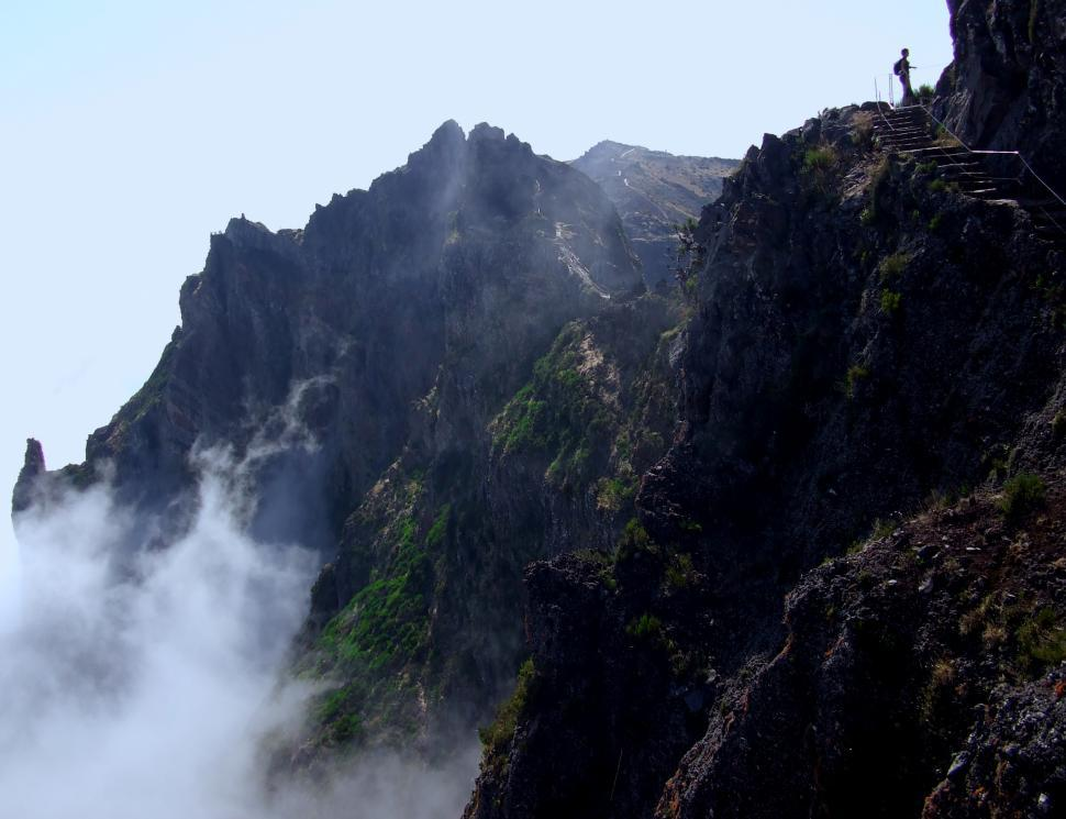 Download Free Stock Photo of Hiker silhouette near the precipice and above cloud level