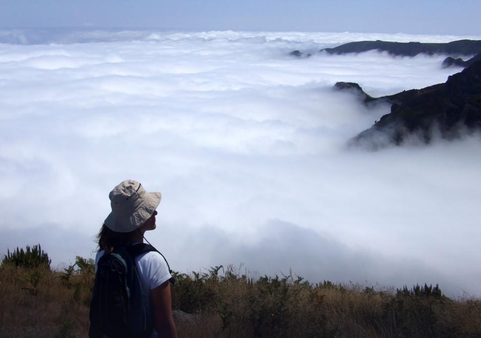 Download Free Stock Photo of Woman hiker gazing at stunning mountain vista