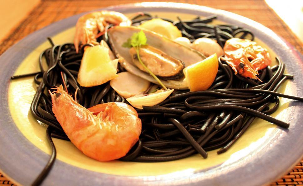 Download Free Stock HD Photo of Linguine al nero di seppia and shellfish Online
