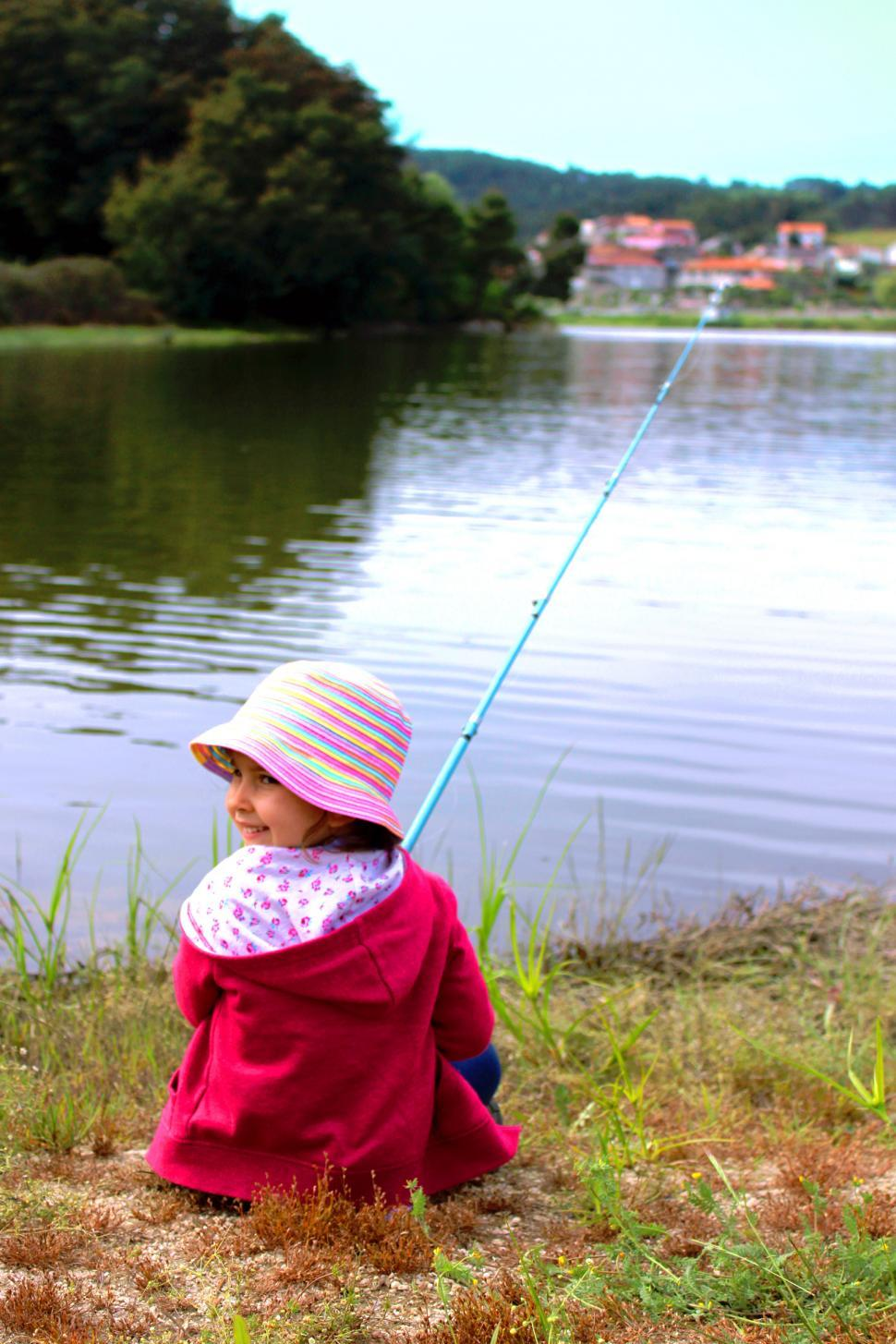 Download Free Stock HD Photo of Little girl fishing and smiling Online