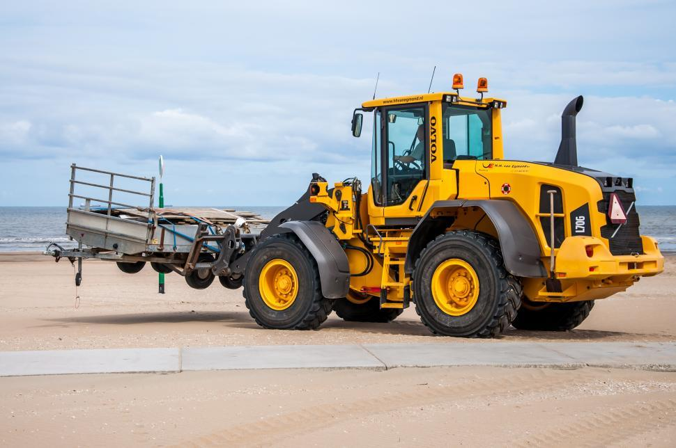 Download Free Stock Photo of bulldozer tractor working on a beach