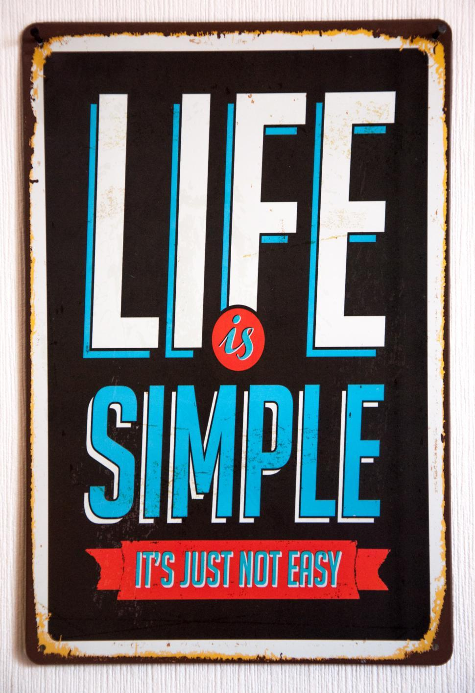 Download Free Stock HD Photo of Vintage Metal Sign Life is simple, its not just easy Online