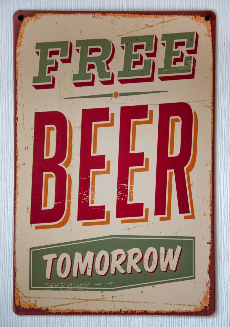 Download Free Stock Photo of Vintage Free Beer Tomorrow Metal Sign