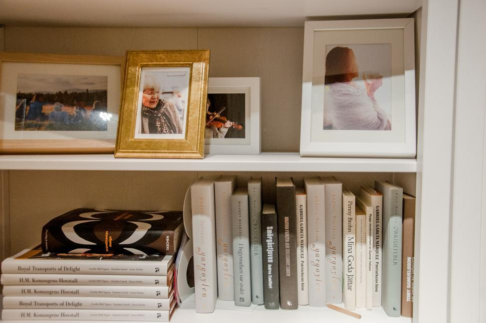Download Free Stock Photo of Bookshelves with books and photoframes