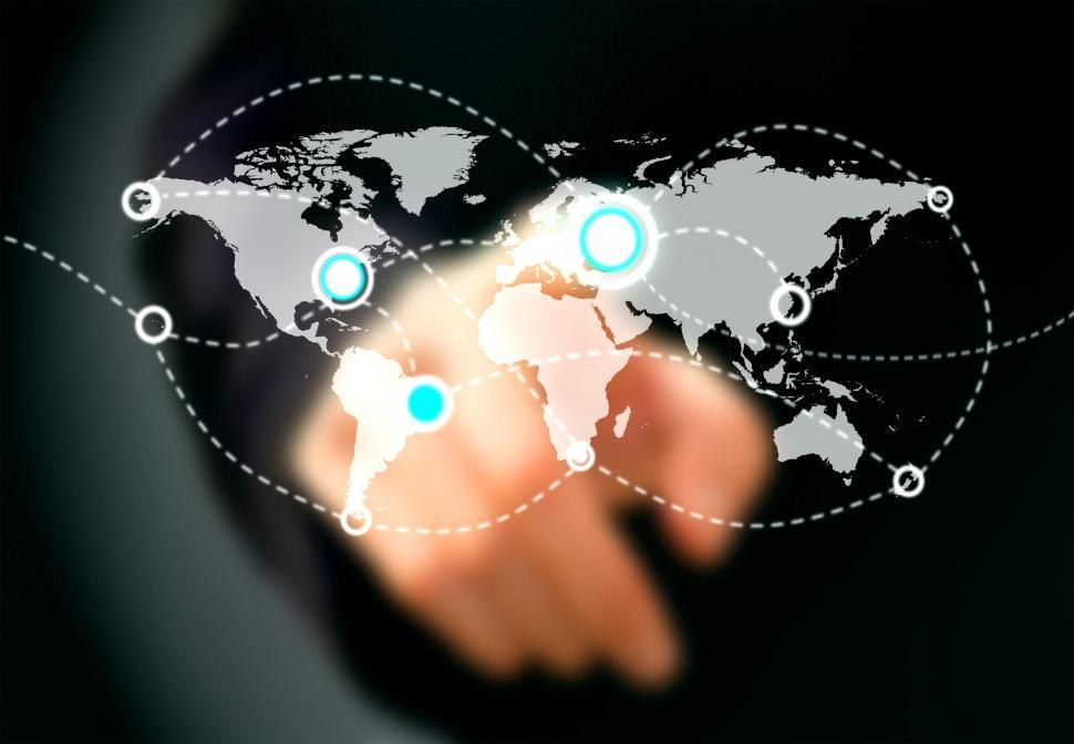 Download Free Stock Photo of Businessman touching virtual screen with world map