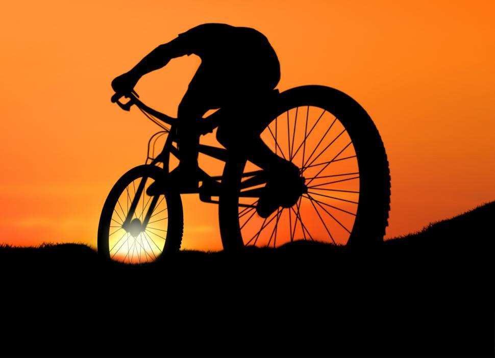 Download Free Stock Photo of Biking into the Sunset