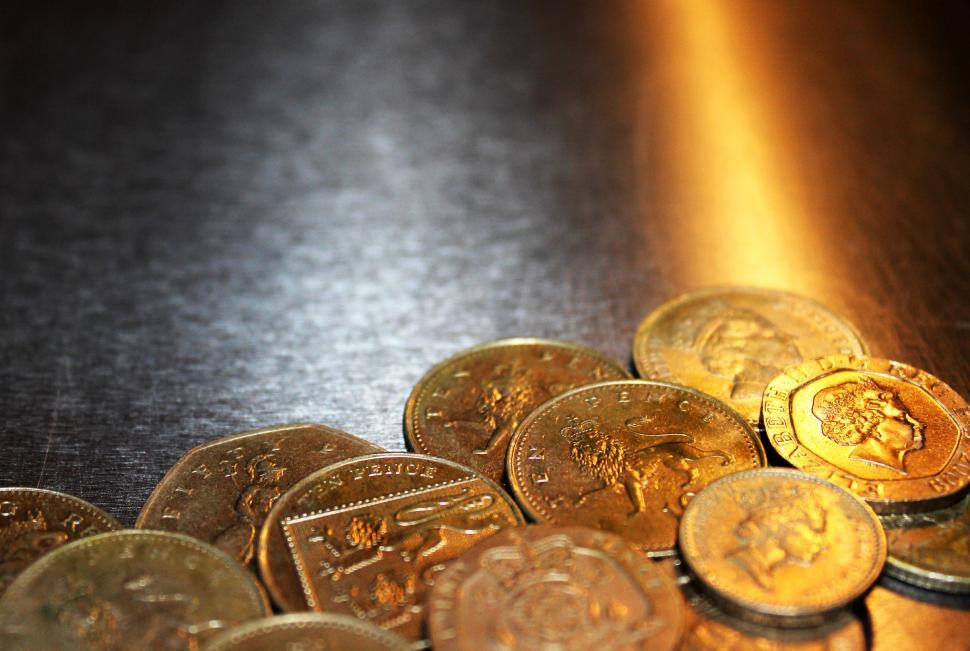 Download Free Stock HD Photo of British pound coins on metal background Online