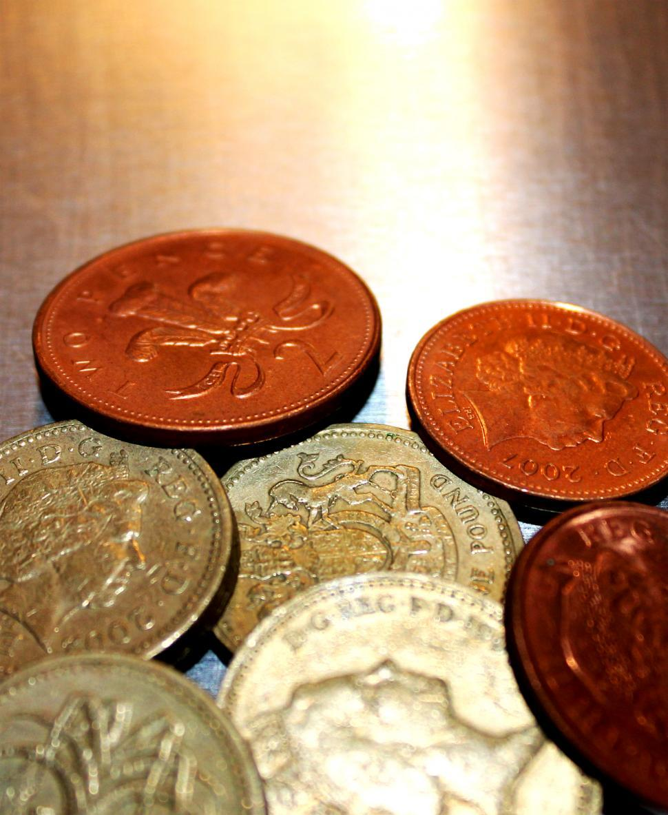 Download Free Stock Photo of British pound coins closeup