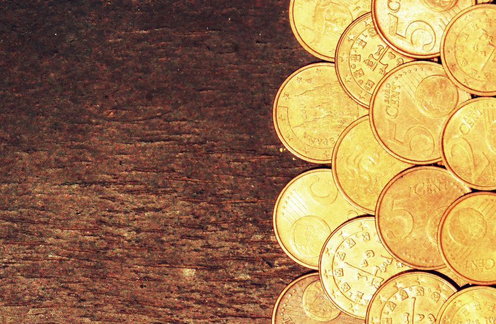 Download Free Stock Photo of Euro coins on old wooden background